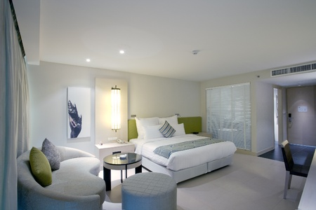Panoramic view of nice stylish modern bedroom  Images on the wall were changed