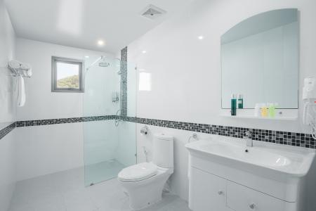 white bathroom: view of nice white tiled modern restroom Editorial