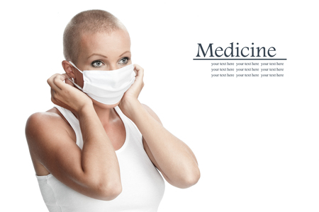 Portrait of nice young woman in surgery mask on white back Stock Photo - 23448168