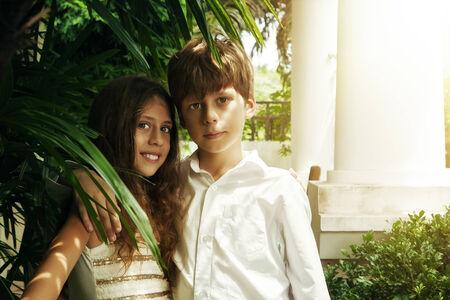 Portrait of little kids having good time in summer environment photo