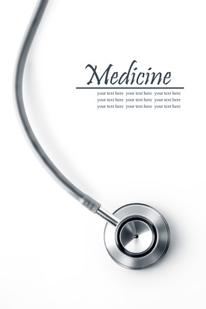 Close up view of grey stethoscope on white back photo