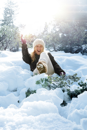 snowbank: Portrait of young beautiful woman on winter outdoor background  Stock Photo