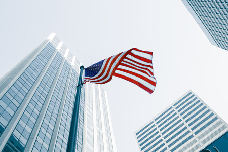 View of American flag on blue building background Stockfoto