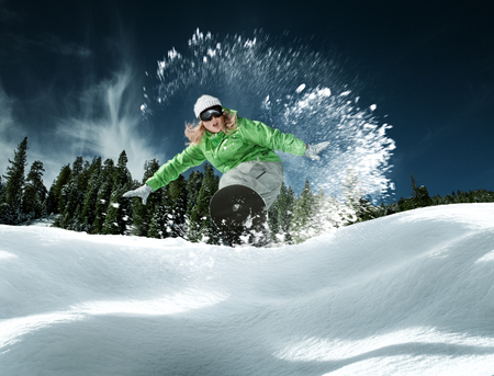 snowboard: view of a young girl snowboarding in winter environment