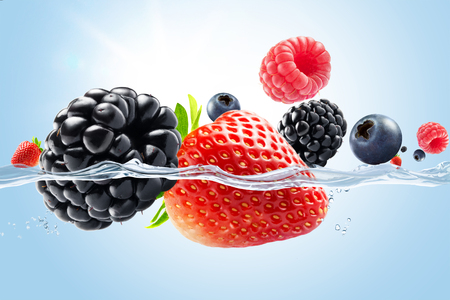 fresh fruit: close up view of nice fresh berries on blue background Stock Photo