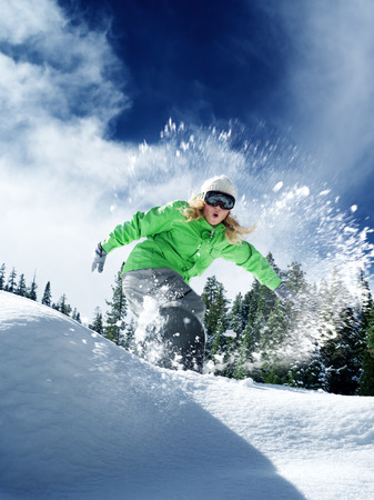ski goggles: view of a young girl snowboarding in winter environment