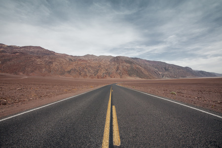 panoramic view of hot summer road through the death valley, nevada photo