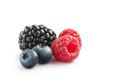 allergic ingredients: close up view of nice fresh berries on white  background