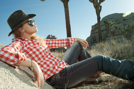 portrait of young beautiful girl in Joshua Tree park environment Stock Photo - 29107918