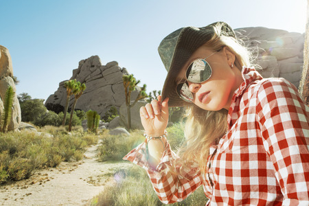 close up portrait of nice young woman in sunglasses and hat Stock Photo - 29107925