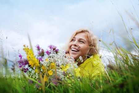 Portrait of young nice woman with flowers in summer environment Stock Photo - 29108109