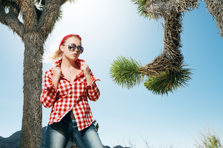 bandana western: portrait of young beautiful girl in Joshua Tree park environment