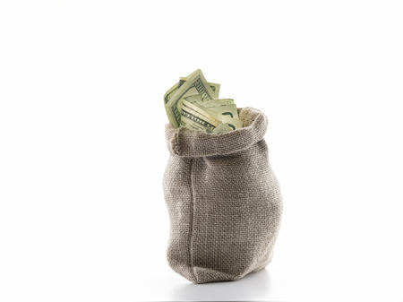 withdraw: close up view of a bag full of cash money dollars bills in amount Stock Photo