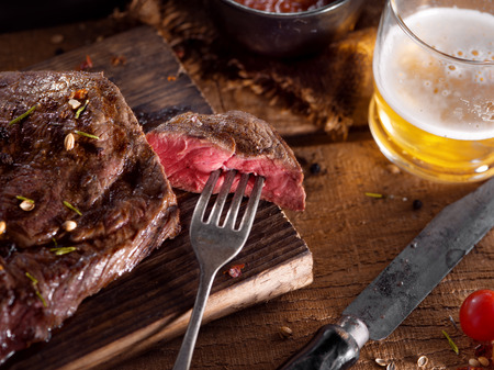 close up view on nice fresh steak on color background Stockfoto