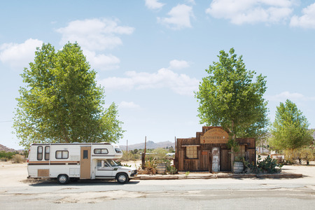 wheel house: view of nice stylish house and car in wild west environment Editorial