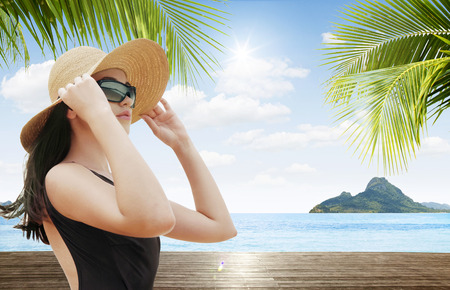 portrait of young beautiful woman in hat and sunglasses photo