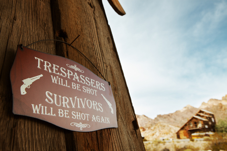 trespass: close up view of old style wild west no trespass sign on the wall