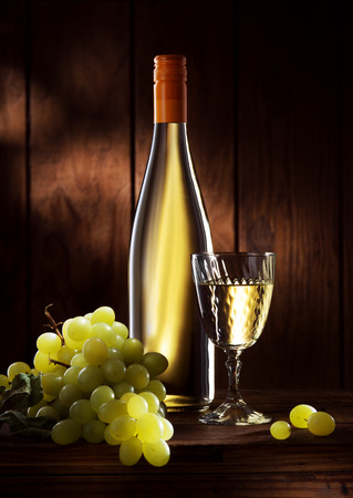 chardonnay: close up view of  glass full of wine and bottles on color background Stock Photo