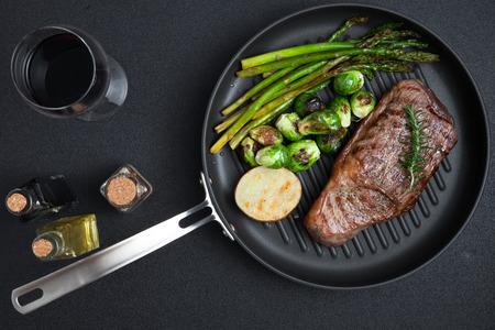 close up view on nice fresh steak on color background Standard-Bild