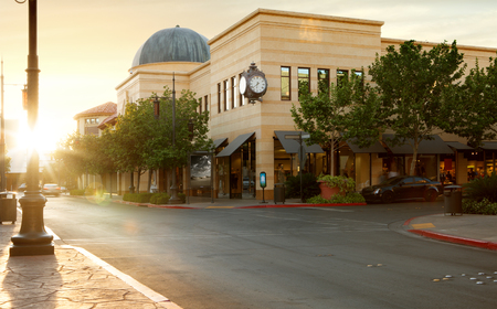 home town: panoramic view of nice home town street during summer sunset