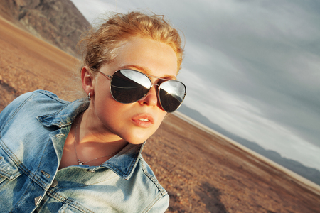 wildwest: portrait of young beautiful girl in death valley  environment Stock Photo