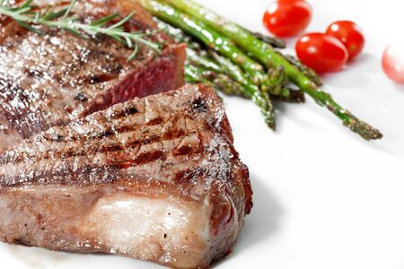 white yummy: close  up view of nice yummy fresh steak  with vegetables on white back Stock Photo