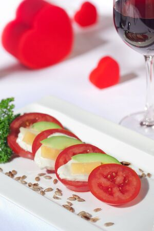 white yummy: close up view of nice yummy caprese salad on white table clothe Stock Photo