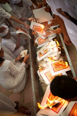 ceremony: view of people burning papers during vegetarian festival in Thailand