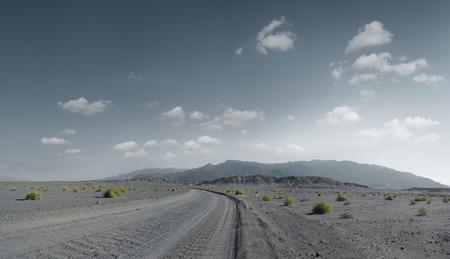 nevada desert: panoramic view of hot dusty  road through the Nevada  desert Stock Photo