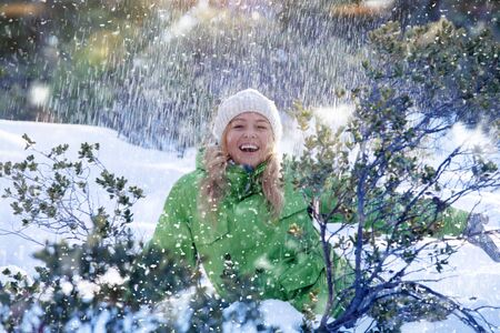 frost winter: Portrait of young beautiful woman on winter outdoor background Stock Photo