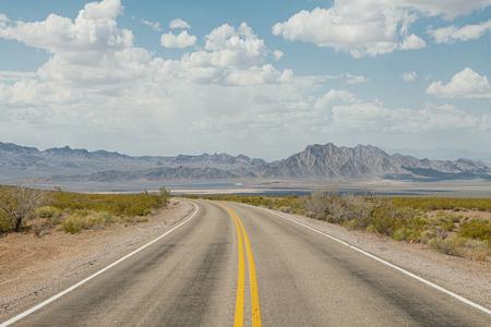 nevada desert: panoramic view of hot summer road through the Nevada  desert Stock Photo