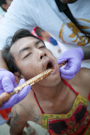fanatic: portrait of the member of vegetarian festival in Phuket, Thailand, oct 2015 Editorial