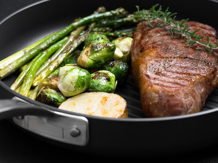 seared: close up view on nice fresh steak on color background Stock Photo