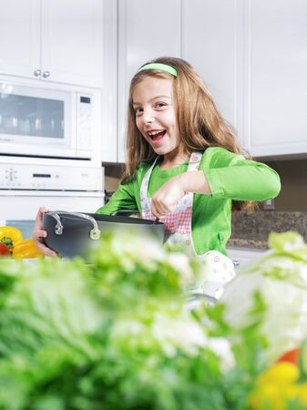 nutrition health: view of young beautiful girl cooking at the kitchen
