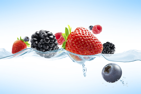 fruit water: close up view of nice fresh berries on blue background Stock Photo