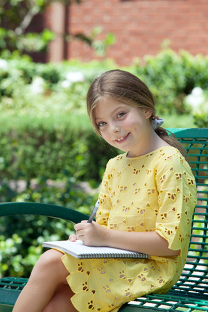 assiduous: portrait of happy girl  having good time in summer environment Stock Photo