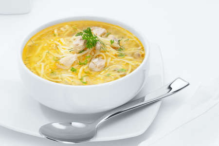 white yummy: close up view of nice yummy russian noodle soup on white back