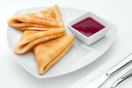 white yummy: close up view of nice yummy crepes with jam on white  table Stock Photo