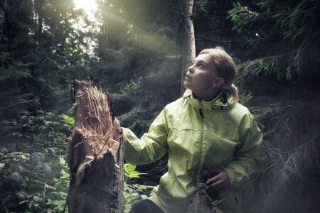 ecological environment: Portrait of nice young girl hanging out in the wood