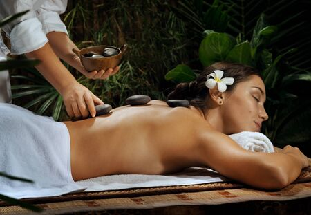 sexual chakra: portrait of young beautiful woman  in spa environment