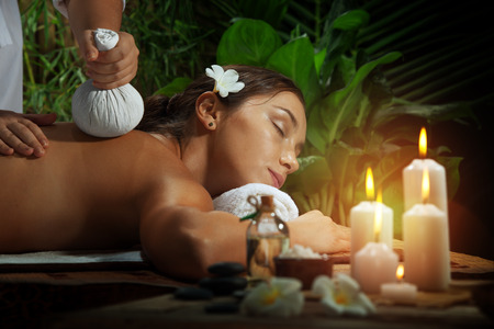 sensual massage: portrait of young beautiful woman in spa environment