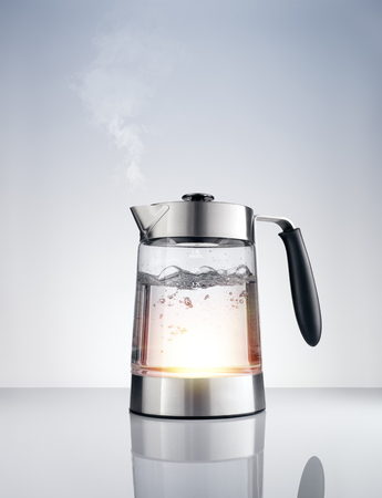 close up view of nice metal tea kettle on grey color background