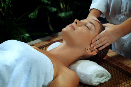 revitalize: portrait of young beautiful woman in spa environment