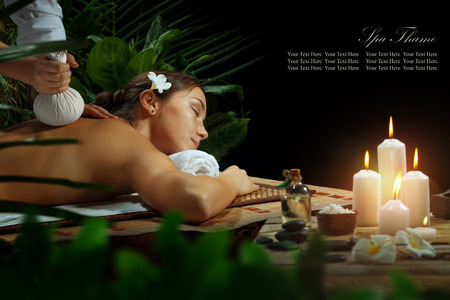 sensual massage: portrait of young beautiful woman in spa environment. Banner, extra space for your text Stock Photo