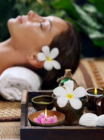 revitalize: portrait of young beautiful woman relaxing in spa environment Stock Photo