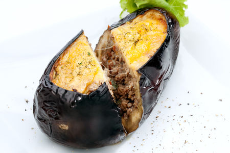 stuffed animals: close  up view of nice yummy baked eggplant  on white back