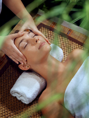 rejuvenate: portrait of young beautiful woman in spa environment