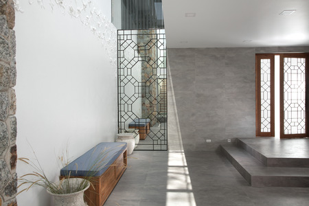 interior wall: view of nice modern style lobby interior with  bench and doorway Editorial