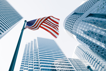 View of American flag on blue building background Stock Photo