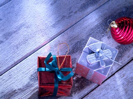 snowbound: close up view  of  gift boxes  on snowbound  wooden back Stock Photo